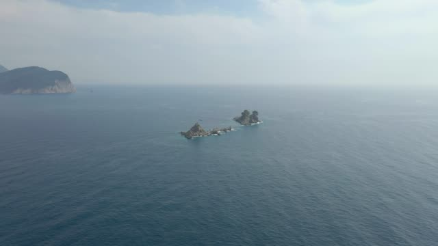 Drone flies to two small Islands in the sea