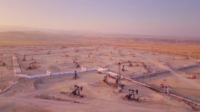 Drone Flight Across California Oil Field at Sunset video