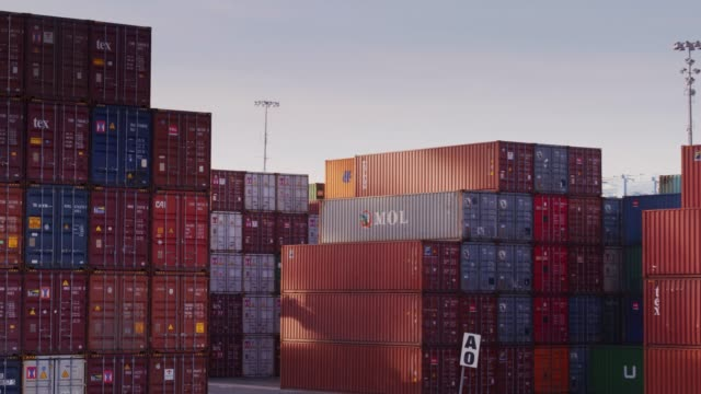 Drone Flight Around Shipping Containers View of an intermodal shipping yard filled with containers in the Port of Long Beach, California. cargo container stock videos & royalty-free footage