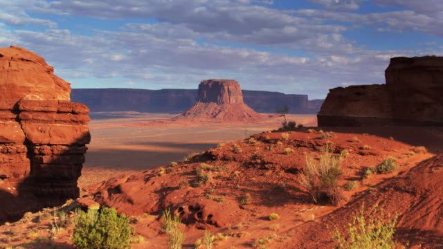 Drone Flight Over Ridge Approaching Merrick Butte, Monument Valley - video