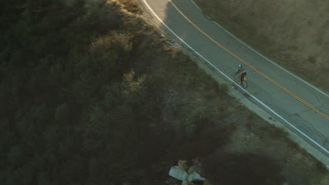 Drone Flight Over Ridge Towards Cyclist on Glendora Mountain Road