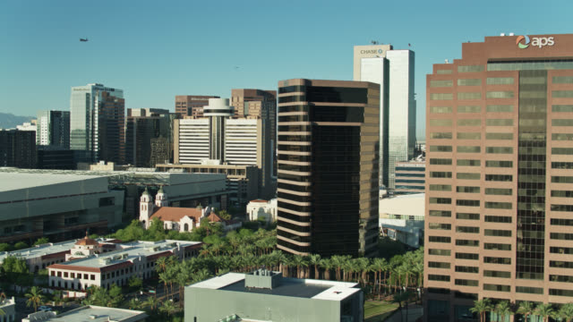 Drone Flight Over Rooftops in Downtown Phoenix on Cloudless Morning