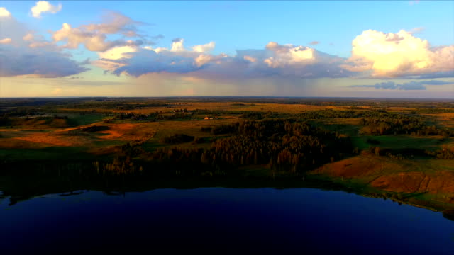 Drone flight over the lake and the fields in environs of Izborks