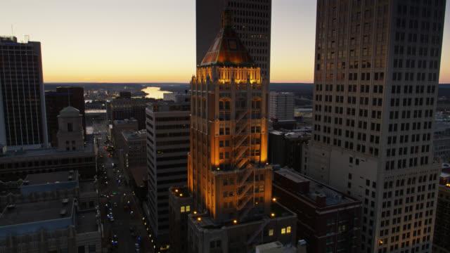 Drone Flight Past Art Deco Philtower Building Lit Up at Night video