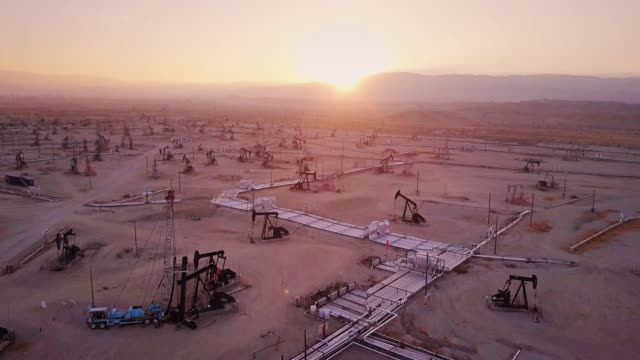 Drone Flight Towards Setting Sun With Downward Tilt Over Midway-Sunset Oil Field, Kern County, California – film