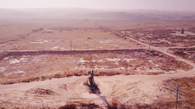 Drone Flight with Tilt Over Pumpjack in Oil Field video