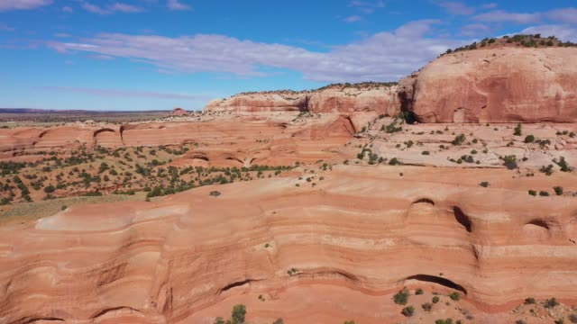 Drone Fly Near Orange Smooth Stone Monoliths Massive Rock Formations In Desert
