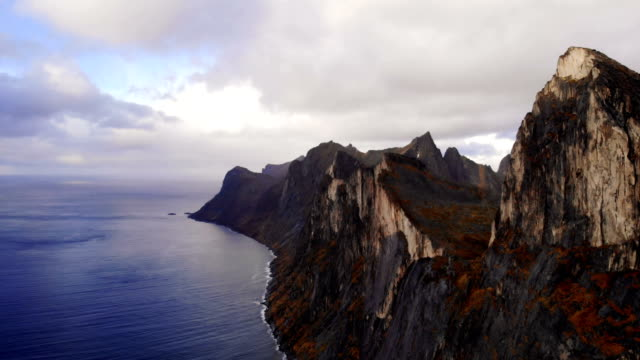 vídeos de stock e filmes b-roll de drone flying above majestic fjords on senja island - reserva natural