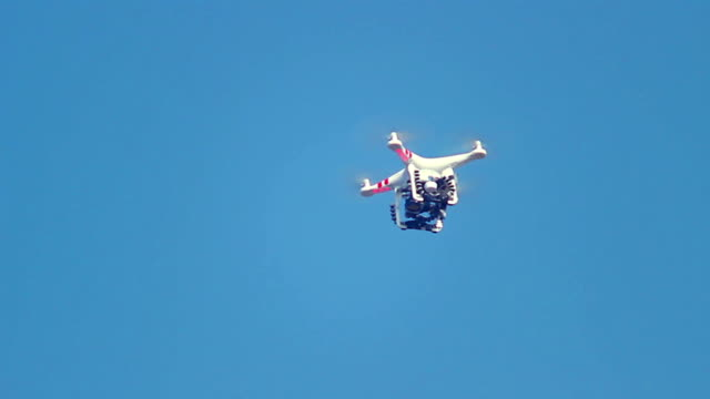 Drone flying in the sky, quadcopter, aerial filming, photography video
