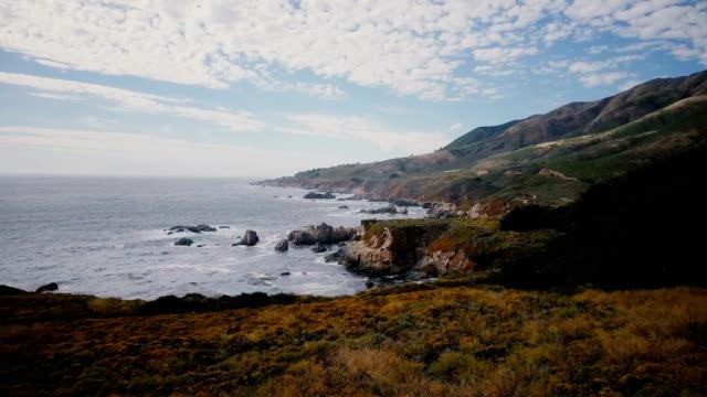 drone flying low above beautiful ocean coast at big sur california, idyllic seaside panorama of summer american nature. - armonia video stock e b–roll