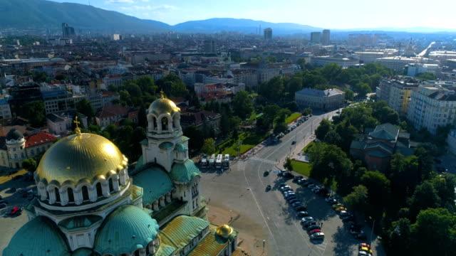 drone flying near city cathedral church in sofia, bulgaria - bułgaria filmów i materiałów b-roll