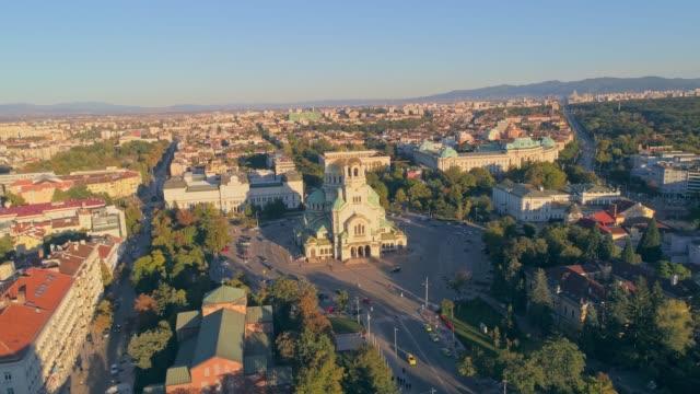 drone flying orbiting around alexander nevski cathedral in sofia, bulgaria - bułgaria filmów i materiałów b-roll