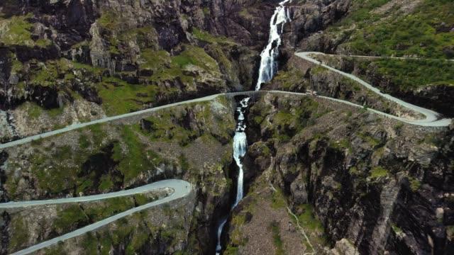 Drone flying over a serpentine mountain road - The Trolls Path - Trollstigen
