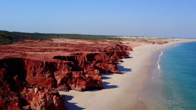 Drone flying over beach and rocks Drone flying over beach and rocks australia stock videos & royalty-free footage