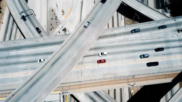 Drone flying over complex structure of Judge Pregerson highway road junction with multiple level bridges and flyovers.