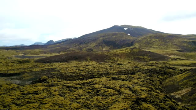 Drone flying over the beautiful lava field in the Iceland. Aerial shoot of the picturesque view in the nature video
