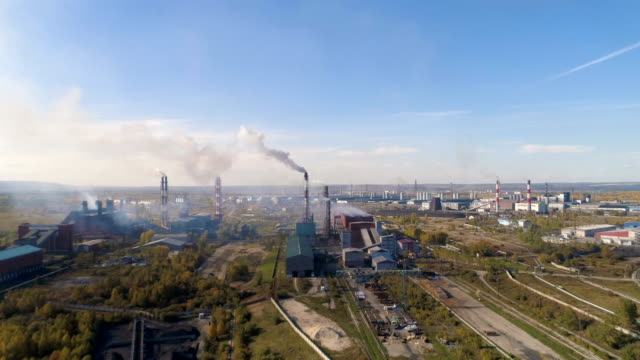 Drone flying over the metallurgical plant. Heavy industry chimneys pollute the air video