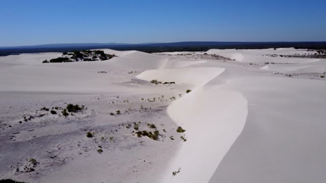 Drone flying over white sandy desert dunes Drone flying over white sandy desert dunes desert oasis stock videos & royalty-free footage