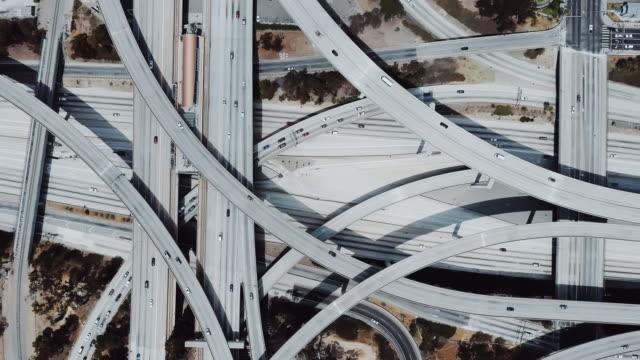 drone flying right revealing amazing highway junction interchange with complex roads, levels and flyovers structure. - estakada skrzyżowanie dróg filmów i materiałów b-roll