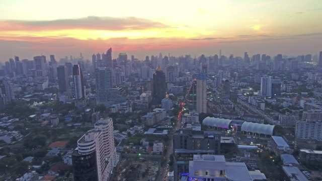 WS Drone flying, Top view of skyscraper which sunset Golden light video