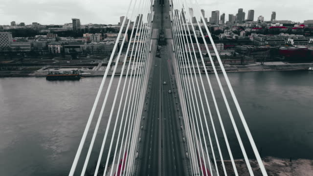 Drone flying up Swietokrzyski Bridge, with just few car passing Post apocaliptic colors of polish capitol Warsaw suspension bridge stock videos & royalty-free footage