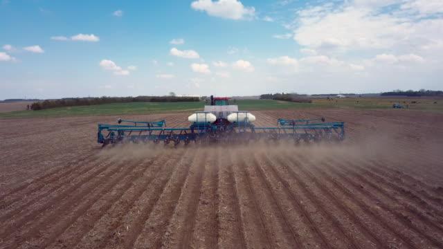 drone following a planter - trattore video stock e b–roll
