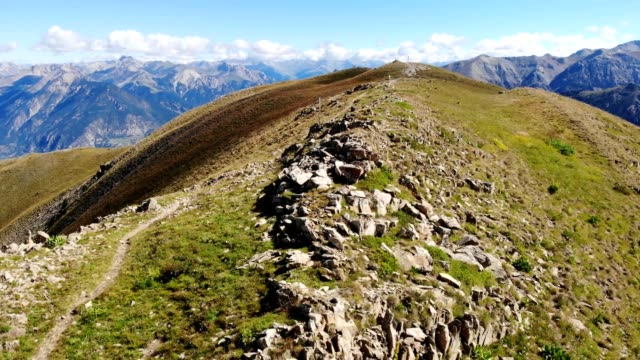 drone footage 4k, flying over a rocky mountains ridge in french alps - hautes alpes stock videos & royalty-free footage