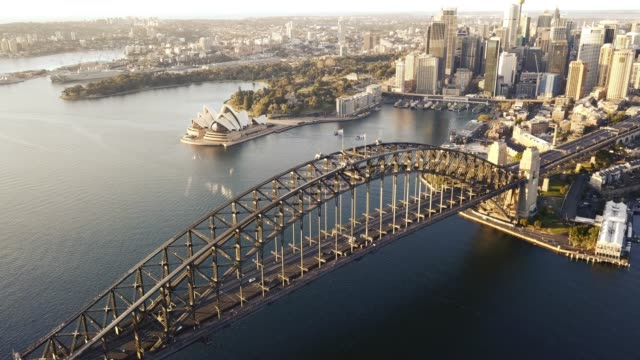 drone footage b-roll of Sydney Harbour Bridge during sunrise.