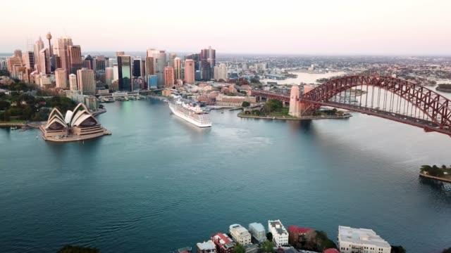 drone footage b-roll of Sydney Harbour Bridge during sunrise.