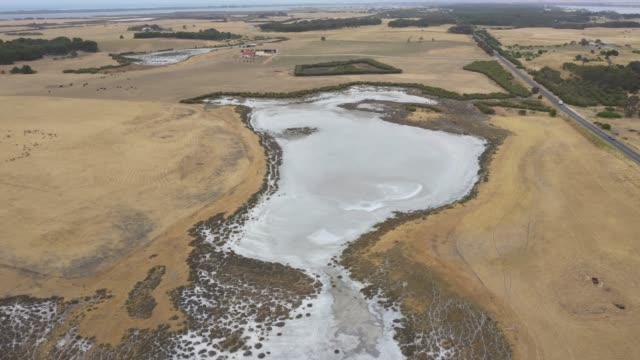 Drone footage of a dry agricultural dam due to the severe drought in Australia video