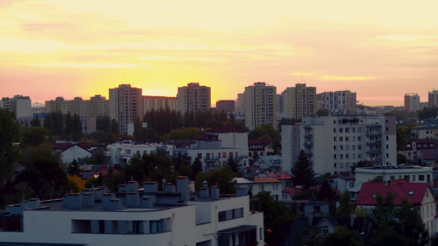 drone footage of blocks of flats at sunset. - polonia video stock e b–roll
