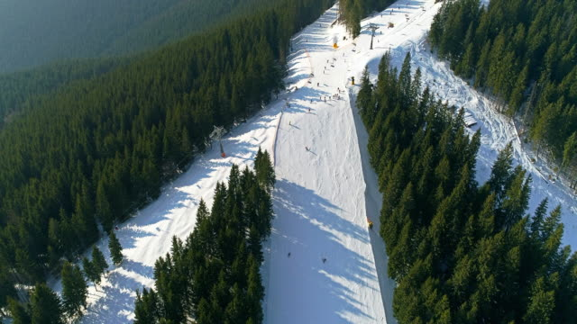 Drone footage of gently sloping mountain at the base of the ski area video