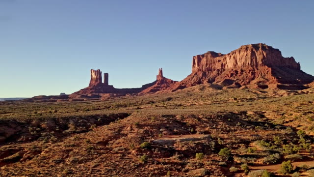 drone footage of monument valley area utah - rock formations stock videos & royalty-free footage