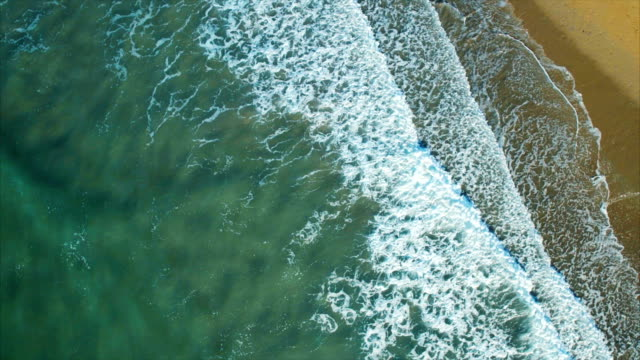 Drone footage of serene waves crashing on shore video