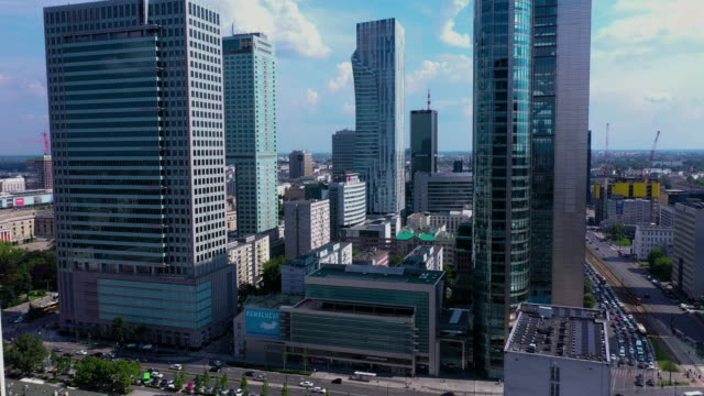 drone footage of skyscrapers in the city center. - польша стоковые видео и кадры b-roll