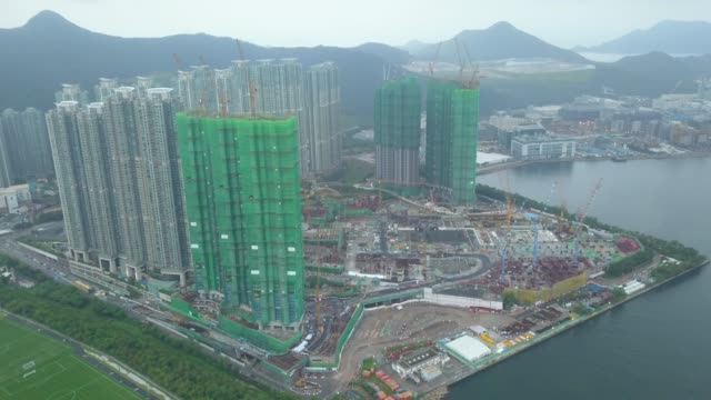 drone footage of tseung kwan o city, hong kong - full hd format video stock e b–roll