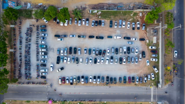 Drone Hyper Timelapse top view over outdoor parking lots