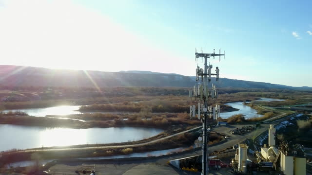 Drone Image of a Cellular Tower in front of Lakes