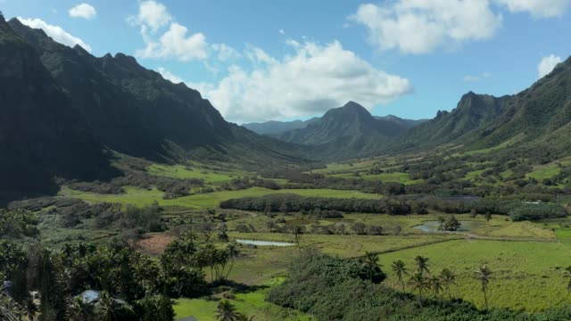 Drone pan across the magical Kaaawa valley with mountains in the background - video