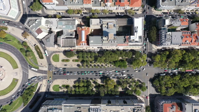 Drone pint view of roundabout with traffic in Lisbon Statue of the Marques de Pombal, A roundabout with traffic, tourists, drone point view portugal stock videos & royalty-free footage