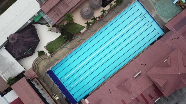 Drone point of view directly above swimming pool with lanes