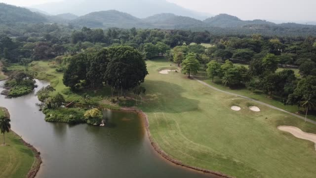 Drone point of view golfer playing golf in golf course in melaka