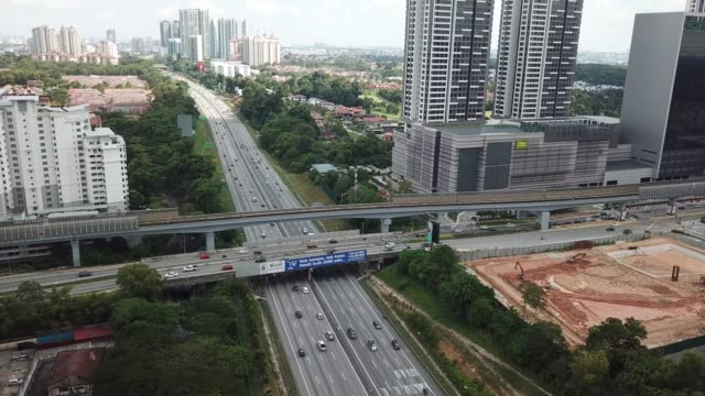 drone point of view of damansara , petaling jaya malaysia view with north south highway and bridge