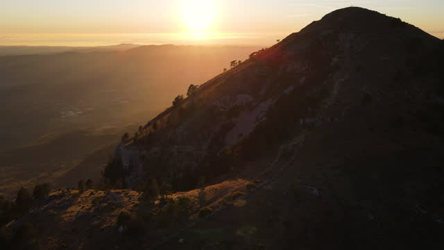 Drone Point of View on Sun Setting Behind a Hill Top video
