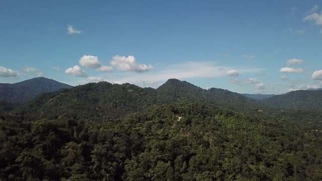 drone point of view tropical rainforest mountain kuala kubu rural scene