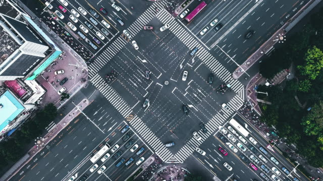 T/L PAN Drone Point View of City Street Crossing at Daytime