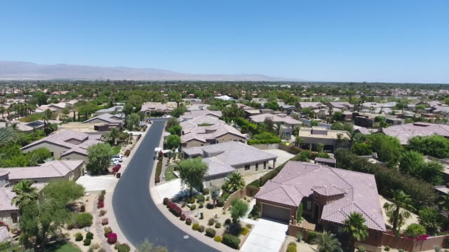 Drone point view of houses with swimming pools in Palm Springs - video