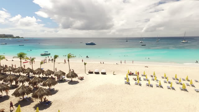 Drone rotation over beach umbrellas in Carlisle Bay, Barbados video