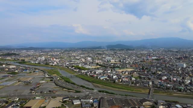 香川県の「観音寺」を撮影したドローン - 斜めから見た図点の映像素材/bロール