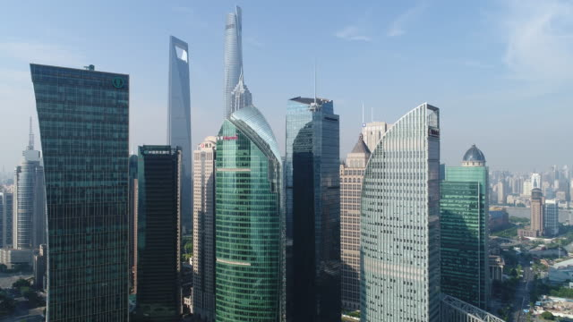 Drone shot: 4K Aerial view of Lujiazui Financial District in Shanghai. Aerial View, City, Cityscape, High Angle View, Huangpu River shanghai stock videos & royalty-free footage